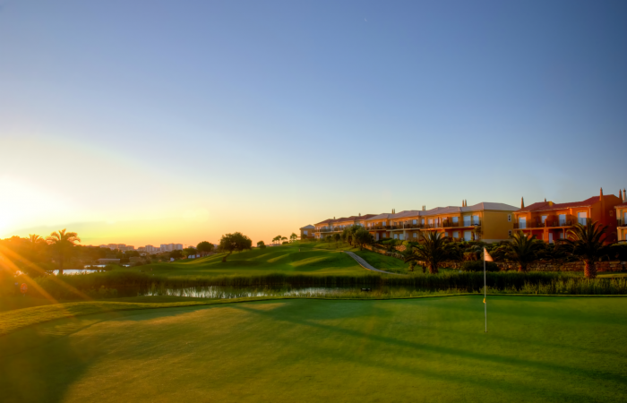 Green of Boavista golf course by the sunset