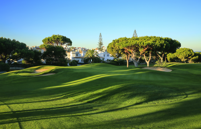 Dom Pedro Pinhal Golf Course with pine trees and houses