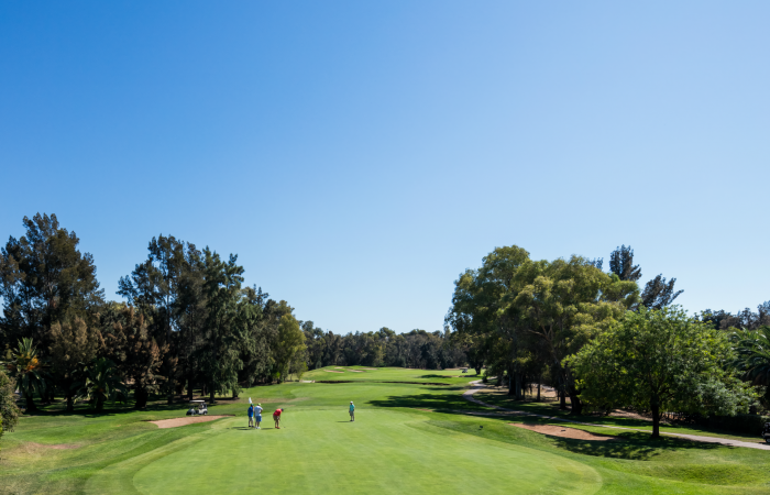 People playing golf in the Penina Course