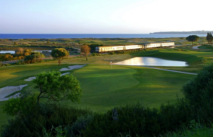 Palmares Golf Course with a train behind passing by