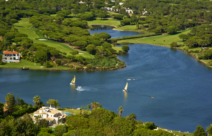 Aerial view of the lake of Quinta do Lago surrounded by the South Golf Course
