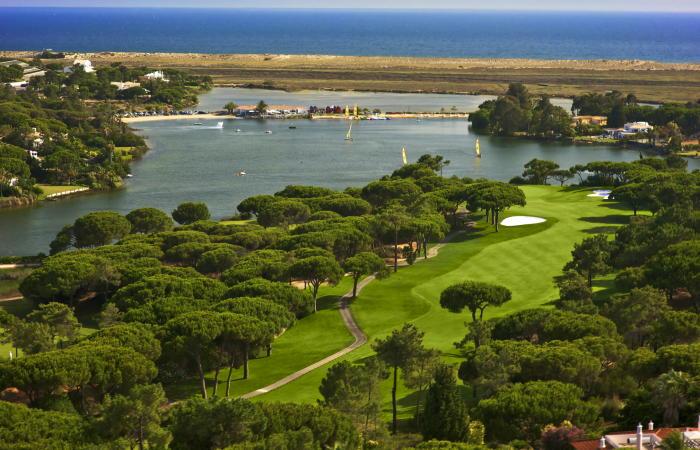 Aerial view of a South Golf Course fairway with lake of Quinta do Lago behind