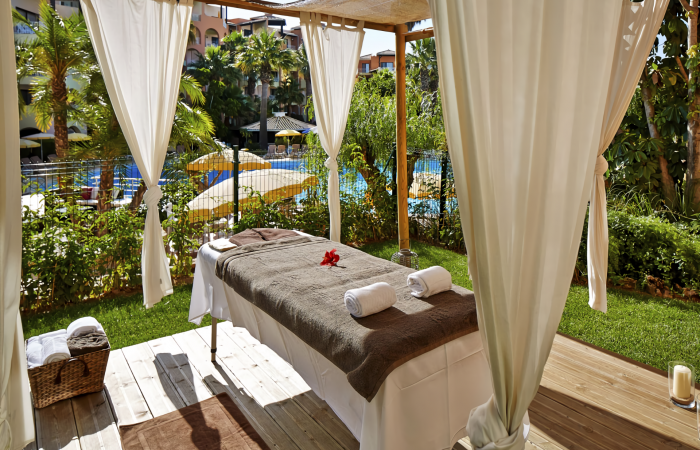 Massage bed close to the pool