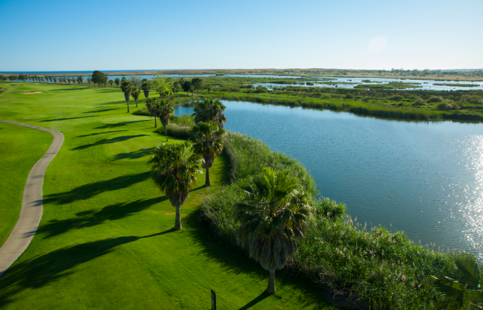 Aerial view of Salgados Golf Course with fairway on the left side and lake on the right side